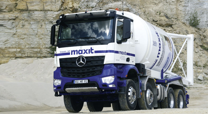 Lorry with the maxit logo in white & blue