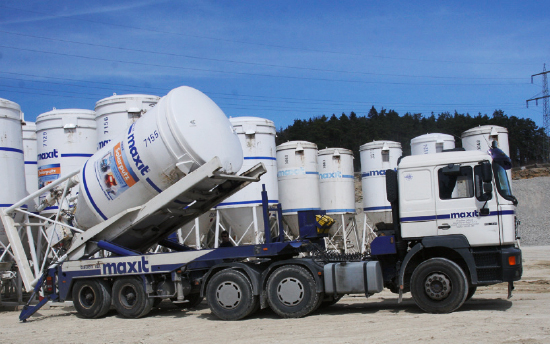 A lorry setting down the silo